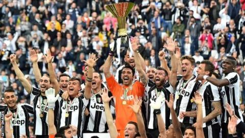 Juventus celebrate with the Serie A trophy
