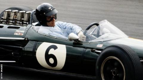 Gurney, pictured driving the Brabham BT7 Climax, during the 1964 British Grand Prix