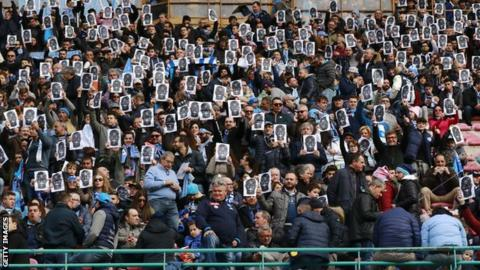Fans wear Kalidou Koulibaly masks at Napoli's Serie A game against Carpi