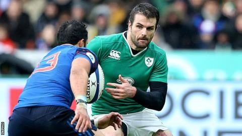 Ireland's Jared Payne attempts to evade France's in the Six Nations game on 13 February