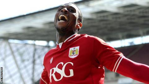 Bristol City's Jonathan Kodjia celebrates scoring against Huddersfield