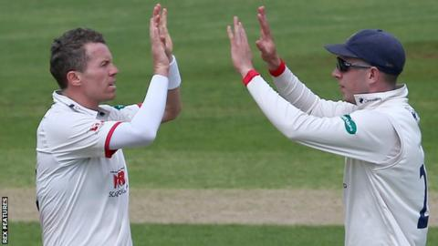 Peter Siddle and Dan Lawrence celebrate a wicket for Essex