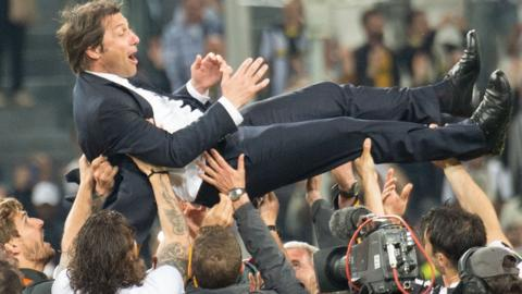 Antonio Conte is lifted in the air after winning the Serie A title as Juventus manager