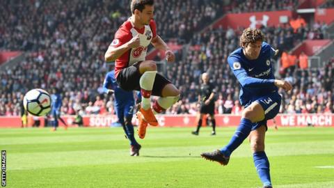 Chelsea defender Marcos Alonso (right) plays a ball past Southampton defender Cedric Soares