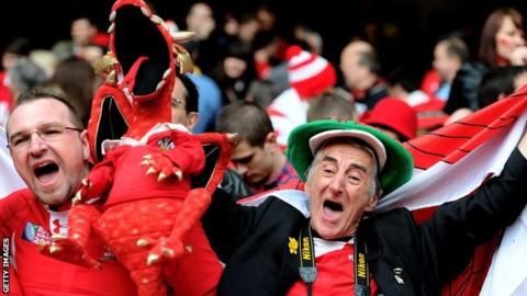 Fans celebrate a Wales rugby win at the Principality Stadium