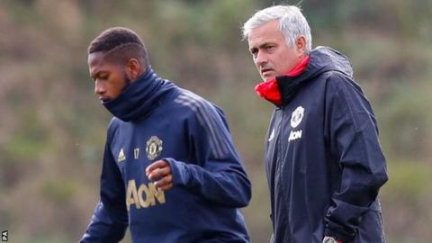 Fred (left) and Jose Mourinho