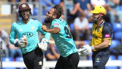 Surrey's Imran Tahir celebrates after taking the wicket of Shaun Marsh