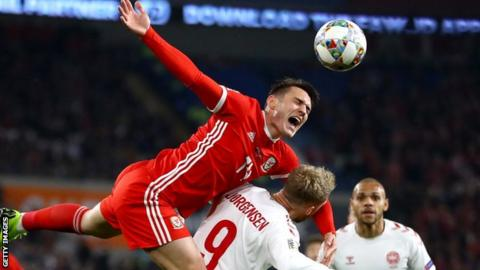Connor Roberts in action for Wales against Denmark