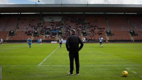 Edinburgh City manager Gary Jardine watching his team play Berwick Rangers