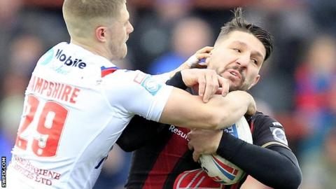 Wakefield's Ryan Hampshire tackles Warrington's Gareth Widdop