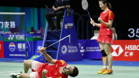 NANJING, CHINA - AUGUST 05: Huang Yaqiong and Zheng Siwei of China celebrates after defeating Huang Dongping and Wang Yilyu of China in the mixed doubles final on day 7 of Total BWF World Championships at Nanjing Youth Olympic Games Sport Park on August 5, 2018 in Nanjing, China. (Photo by Fred Lee/Getty Images)