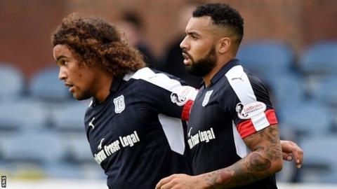 Kane Hemmings (right) celebrates scoring for Dundee against Dumbarton