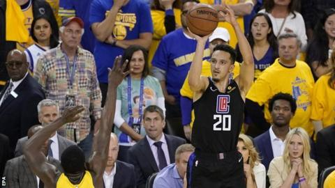 Los Angeles Clippers guard Landry Shamet rises up to hit the sport-a success three-pointer against the Golden Order Warriors