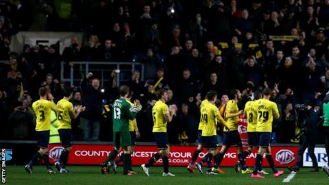 Oxford United players celebrate reaching the JPT final