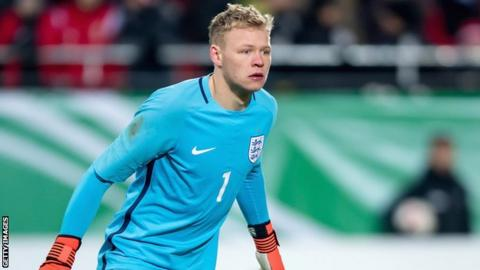 Aaron Ramsdale watches from his goal during an England Under-20 friendly against Germany