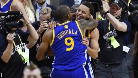 Golden State's Stephen Curry and Andre Iguodala celebrate