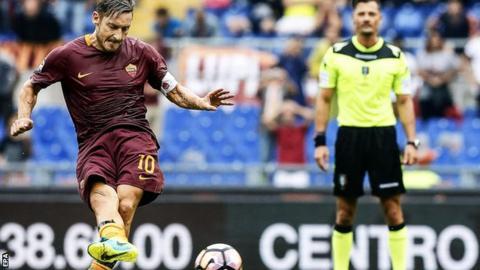 Francesco Totti scores a penalty for Roma