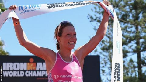 Holly Lawrence celebrates winning the half ironman 70.3 World Championship