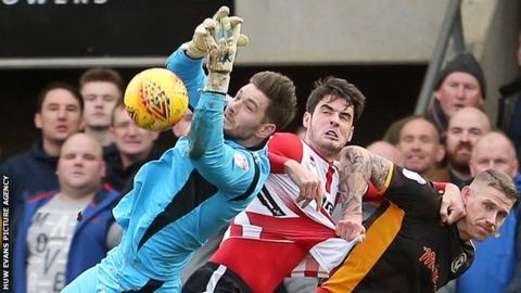 Newport County's Joe Day saves a goal-bound effort against Cheltenham Town