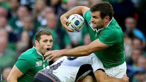 Darren Cave and Jared Payne in action for Ireland against Romania on Sunday