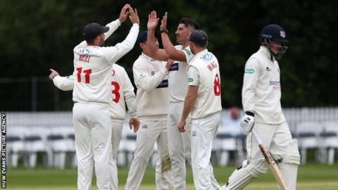 Glamorgan celebrate the wicket of Miles Hammond