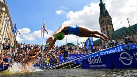 Yuko Takahashi of Japan and Verena Steinhauser of Italy compete in the swing leg of the ITU World Triathlon Hamburg Mixed Relay World Championships