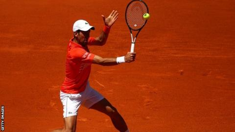 Novak Djokovic in action against Jeremy Chardy in the Madrid Open third round