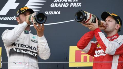 Mercedes AMG F1 driver Lewis Hamilton and Ferrari F1 driver Sebastian Vettel on the podium at the 2015 Japanese Grand Prix