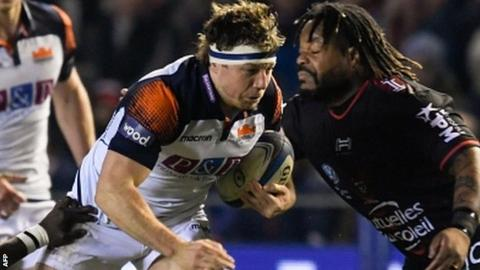 Hamish Watson takes on Toulon centre Mathieu Bastareaud