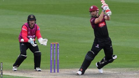 Somerset batsman James Hildreth (right) plays a shot
