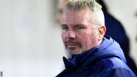 Brian McClair watches a Scotland Under-17s match