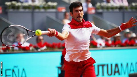 Novak Djokovic plays a forehand during his first round match against Kei Nishikori at the Madrid Open