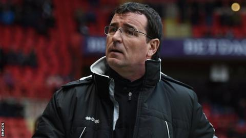 Blackpool manager Gary Bowyer looks up at the stands ahead of his side's game at Charlton