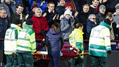 Hearts defender Callum Paterson is carried off on a stretcher