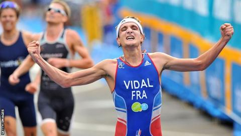 Laurent Vidal celebrates victory in a Triathlon World Series event