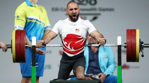 Ali Jawad of England celebrates a lift in the men's lightweight final during the Para Powerlifting on day six of the Gold Coast 2018 Commonwealth Games at Carrara Sports and Leisure Centre