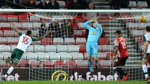 Ethan Pinnock scores for Barnsley at the Stadium of Light