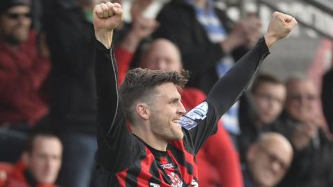 Diarmuid O'Carroll of Crusaders celebrates after scoring in the 1-0 victory over Warrenpoint which put the champions top of the Premiership on goal difference