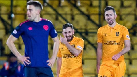Livingston's Ryan Hardie (right) celebrates his second goal with teammate Steven Lawless