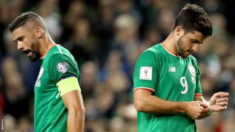 Jonathan Walters and Shane Duffy show their disappointment after the Republic's defeat