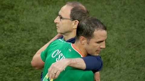 John O'Shea embraces Martin O'Neill after his substitution at the Aviva Stadium