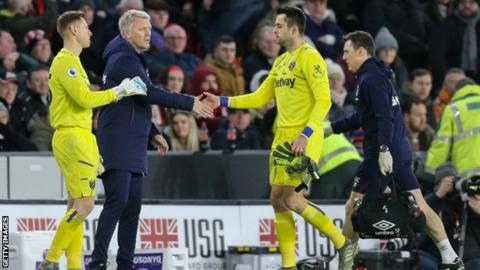 Lukasz Fabianski is replaced by David Martin after being injured against Sheffield United