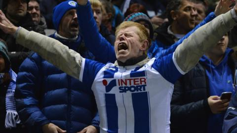 A Wigan fan sings