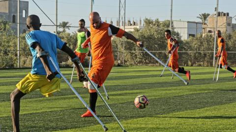 Palestinian amputee soccer players take part in a training session of their team at Municipality Stadium in Deir Al Balah