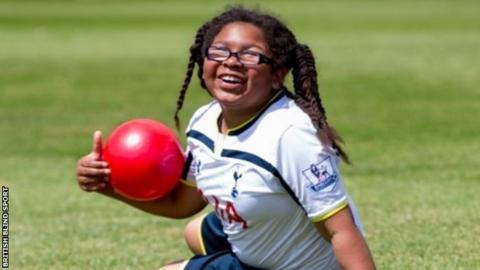 A visually impaired girl with ball
