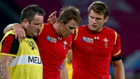 Liam Williams (centre) leaves the field during Wales' World Cup defeat to Australia in October 2015