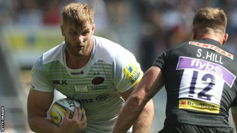 Saracens lock George Kruis takes on Sam Hill of Exeter