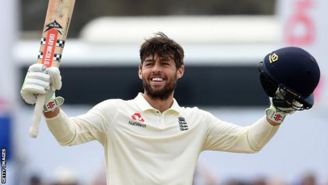 England wicketkeeper Ben Foakes celebrates his maiden Test century by raising his bat and helmet in the first Test against Sri Lanka in Galle
