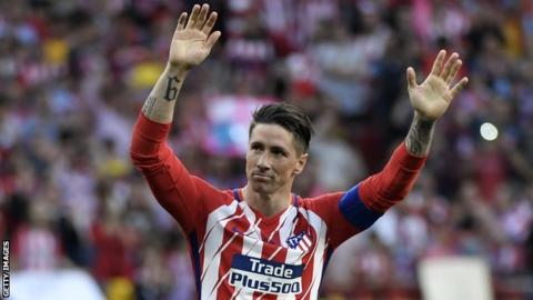Atletico Madrid striker Fernando Torres waves to the crowd