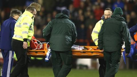 Britt Assombalonga is carried off on a stretcher after being injured in the win over Wigan Athletic in February